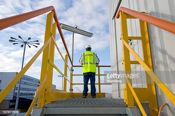 An employee inspects the freight rail loading section at the Grupa Lotos SA oil refinery in Gdansk Poland on Monday Dec 6 2010 Russian companies such...