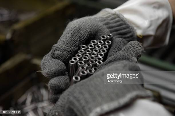 An employee inspects vehicle parts at an Asahi Tekko Co factory in Hekinan Aichi Prefecture Japan on Wednesday Aug 1 2018 Japan's government...