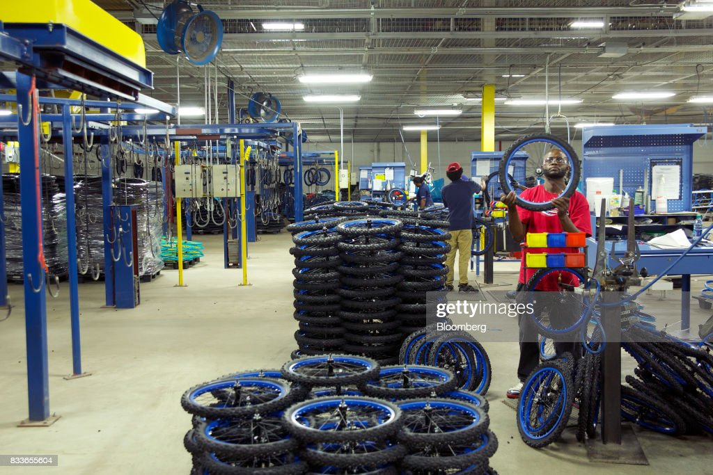 An employee inspects wheels for the Boys MT20 model bicycle at The Kent International Inc. Bicycle Corporation of America brand Assembly facility in Manning, South Carolina, U.S., on Sunday, June 25, 2017. Almost all of the roughly 18 million bicycles sold each year in the U.S. come from China and Taiwan. This year, about 130 workers at the Bicycle Corporation of America's new factory will assemble 350,000 bikes in the U.S. Photographer: Travis Dove/Bloomberg via Getty Images