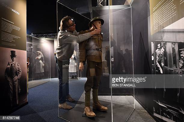 An employee installs a model depicting a 'Tommy' soldier wearing uniform and kit of the British infantryman in 1916 as part of World War I exhibition...