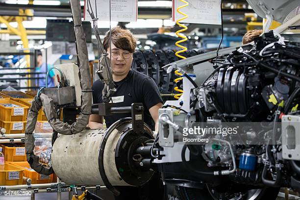 An employee installs a wheel on a Hyundai Motor Co. Elantra vehicle on the production line at the company's plant in Ulsan, South Korea, on Monday,...