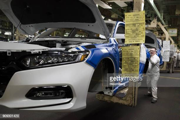An employee installs bumpers on 2018 Honda Accord vehicles during production at the Honda of America Manufacturing Inc Marysville Auto Plant in...