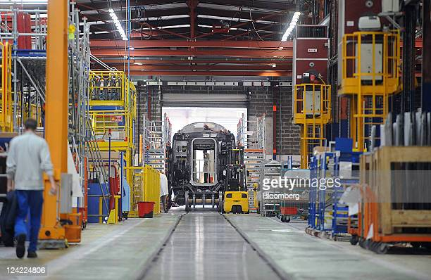 An employee installs wiring inside a TGV locomotive at the Alstom SA train factory in La Rochelle France on Thursday Sept 8 2011 East Japan Railway...