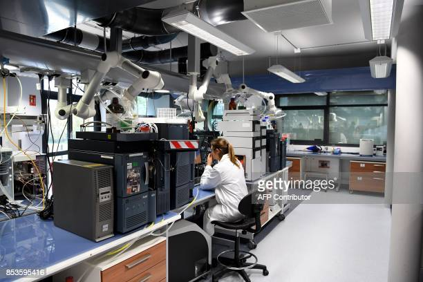 An employee is at work at Allergan's RD and global production site on September 25 2017 in Pringy Allergan is a global pharmaceutical company focused...