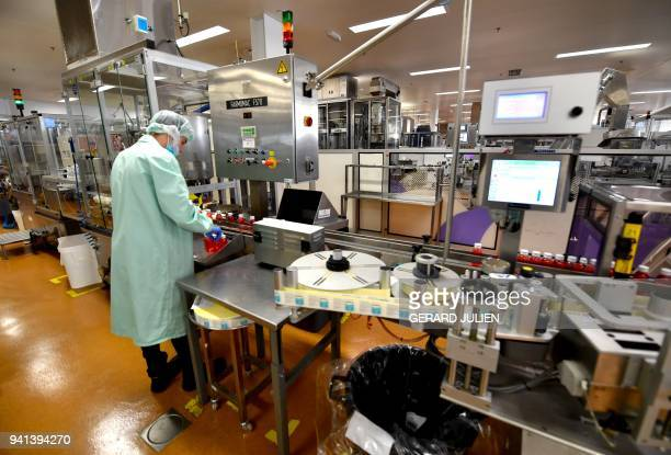 An employee is at work at the plant of French multinational pharmaceutical company 'Pierre Fabre' in Gien on March 21 2018 The Gien site is the...