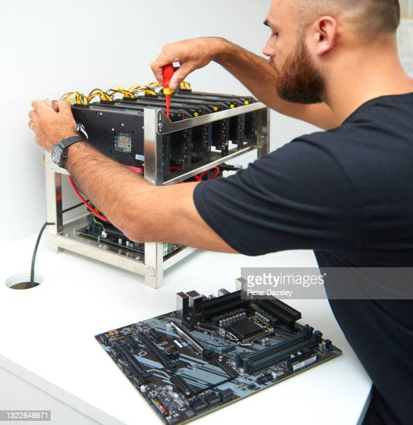 An employee is seen building a cryptocurrency units to mine and to trade bitcoin at Trio Mining on June 3,2021 in London, England.