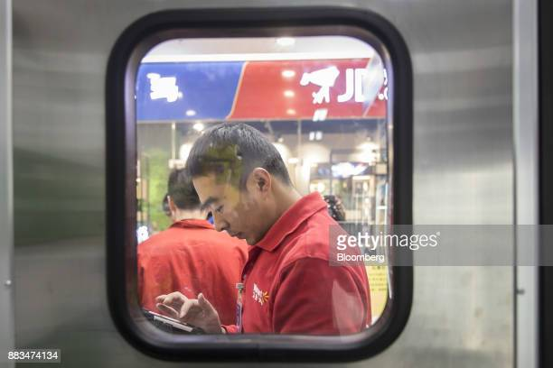 An employee is seen through a window at a WalMart Stores Inc miniwarehouse for the company's onehour delivery service in Shanghai China on Friday Nov...