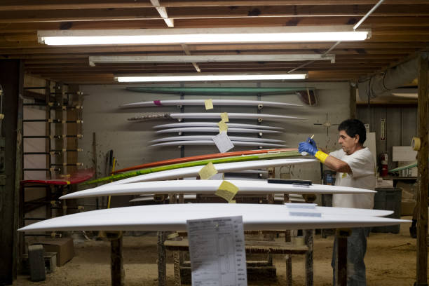 FL: Ricky Carroll Surfboard Facility As Markit Manufacturing Figures Are Released