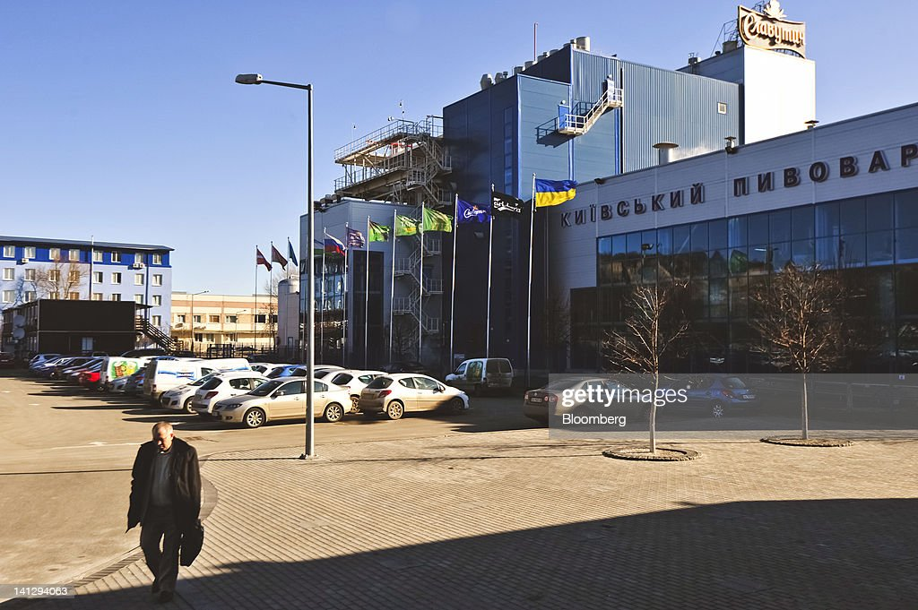 An employee leaves work at the Carlsberg A/S production plant in Kiev, Ukraine, on Wednesday, March 14, 2012. Sales in the Ukraine were 'significantly higher,' helped by better economic conditions and the recent introduction of premium beers, while the U.K. saw 'continuing strong growth,' the brewer said. Photographer: Vincent Mundy/Bloomberg via Getty Images