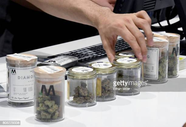 An employee lines up cannabis products at Essence Vegas Cannabis Dispensary after the start of recreational marijuana sales began on July 1, 2017 in...