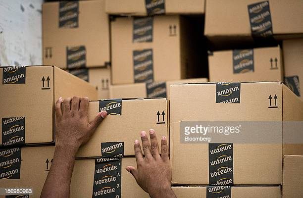 An employee loads a truck with boxes to be shipped at the Amazoncom Inc distribution center in Phoenix Arizona US on Monday Nov 26 2012 US retailers...