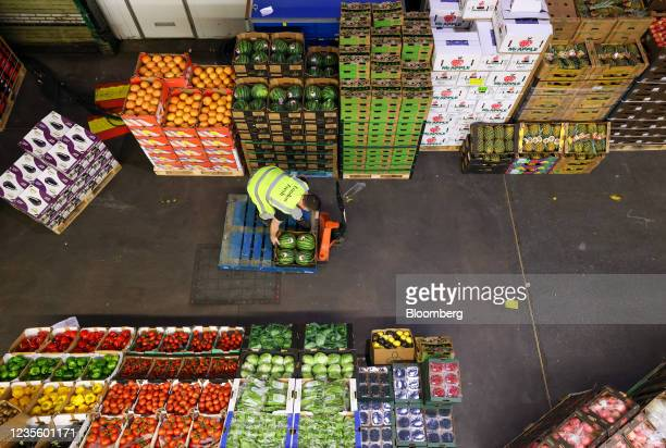 An employee loads an order on to a manual pallet truck in the Buyers Walk at New Covent Garden Market wholesale market in London, U.K., on Wednesday,...