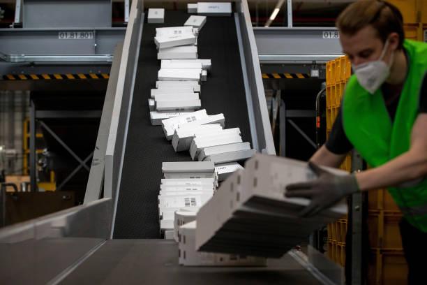 DEU: Deutsche Post AG Sorting Office Ahead of Earnings
