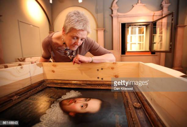 An employee looks at a portrait of William Shakespeare as it arrives at The Shakespeare Birthplace Trust on April 17 2009 in StratforduponAvon...