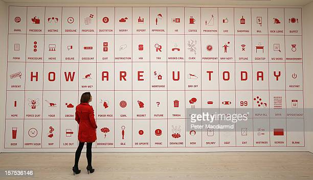 An employee looks at artist Justin Wong's 'Difficult Life Station' at the 'Hong Kong Eye' exhibition at Saatchi Gallery on December 4 2012 in London...