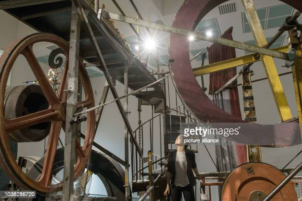An employee looks at the 'Meta Maxi Maxi Utopia' machine by Swiss artist Jean Tinguely from 1987 at the Kunstpalast museum in Duesseldorf, Germany,...