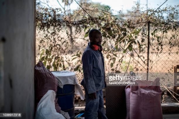 An employee looks on as he works at the Eco Products lab headquarters in Louis Trichardt in the Limpopo Province on August 27 2018 About 1000 women...