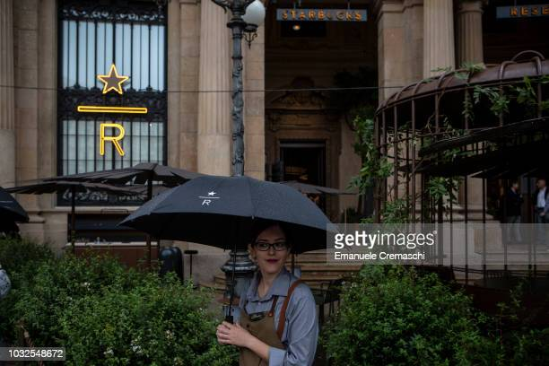 An employee looks on during the opening of Europe's largest and Italy's first Starbucks Reserve Roastery located inside a historic post office in...