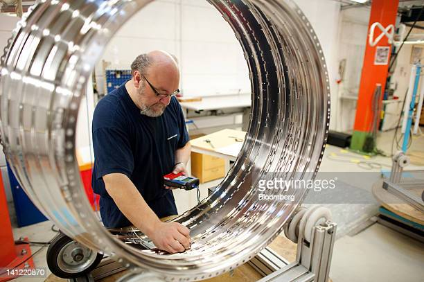 An employee makes a quality control check on an aircraft engine component at the Volvo Aero factory a division of Volvo AB in Trollhaettan Sweden on...