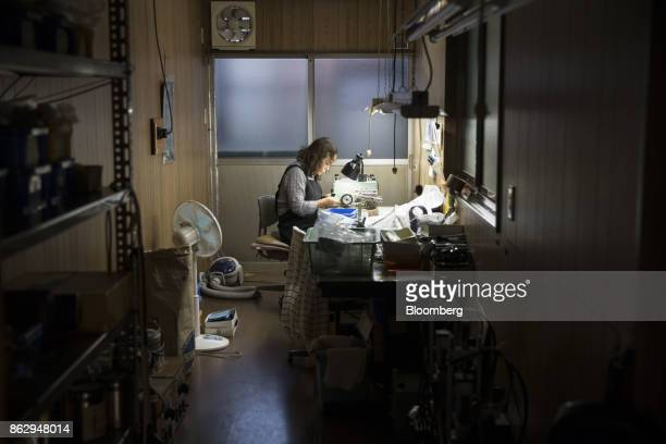An employee makes an eyeglass temple at a Nagai Co factory in Sabae Fukui Prefecture Japan on Tuesday Oct 10 2017 Fukui Prefecture has one of the...