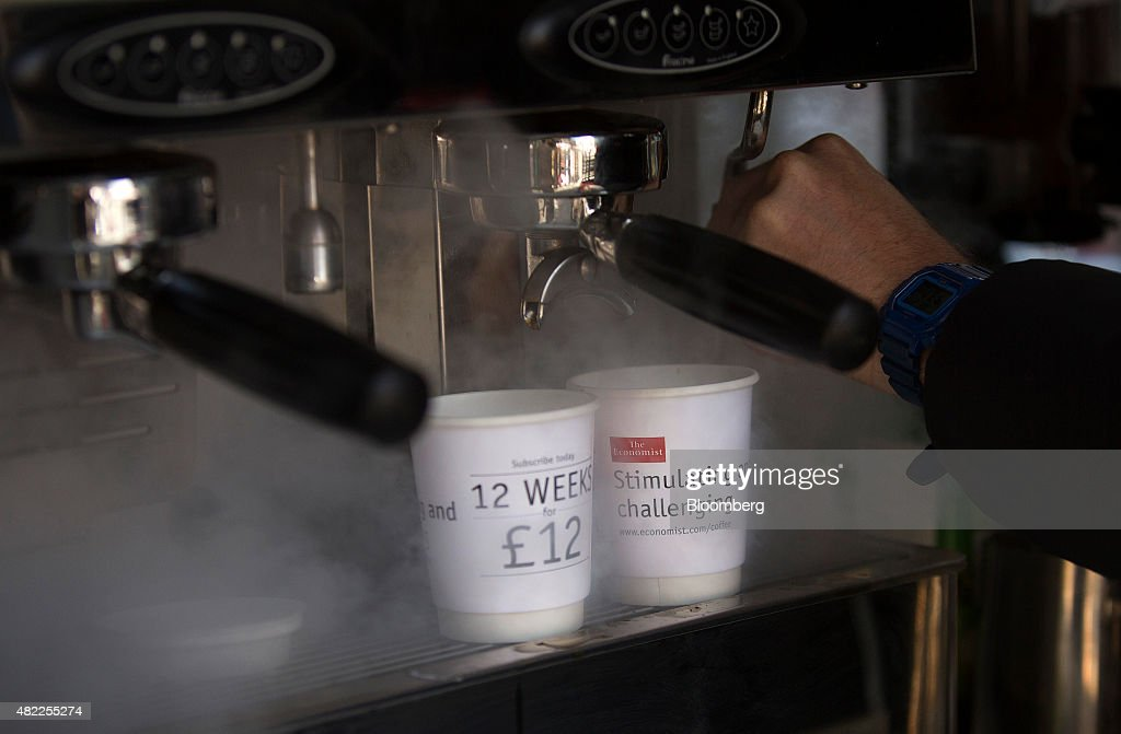 An employee makes Kopi Luwak Civet coffee for customers during a promotional subscription event for The Economist magazine, in London, U.K., on Wednesday, July 29, 2015. Pearson Plc moved closer to an exit from business publishing as it announced plans to dispose of its stake in the 172-year-old Economist magazine, just days after the sale of the Financial Times newspaper. Photographer: Simon Dawson/Bloomberg via Getty Images