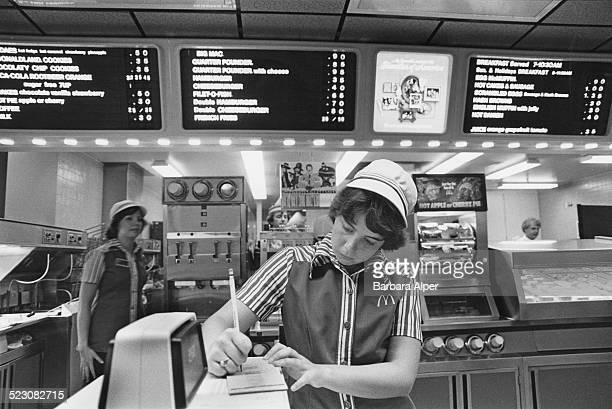 An employee makes notes at the counter in McDonald's Southfield Michigan USA July 1978