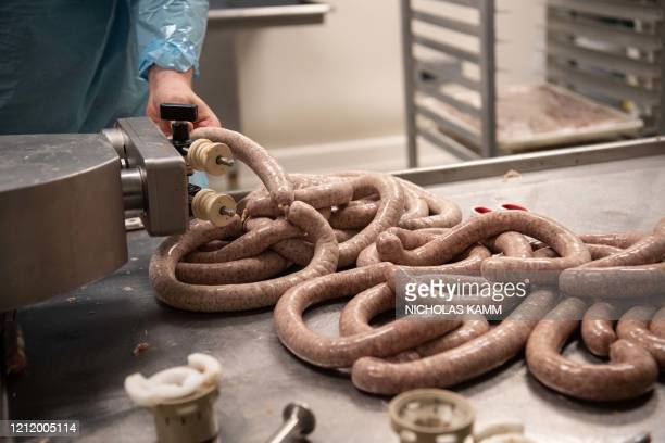 An employee makes sausage at Jamie Stachowski's factory in Capitol Heights, Maryland, on May 6, 2020. - As the coronavirus pandemic continues to...