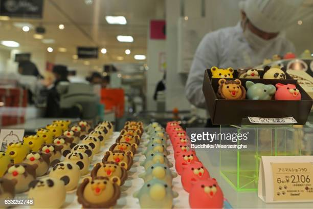 An employee makes Valentine's Day animal chocolates at a Hankyu Department Store on February 1 2017 in Osaka Japan Department stores in Japan set up...
