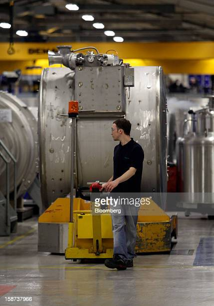 An employee maneuvers a magnet manufactured for use in Magnetic Resonance Imaging scanners through the Siemens AG Magnet Technology factory in Oxford...