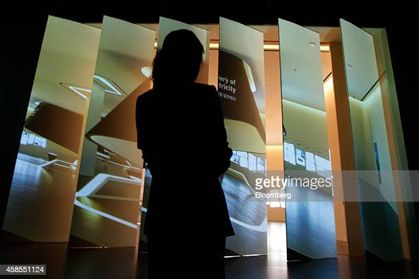 An employee maneuvers remotecontrolled screen panels inside the Samsung Innovation Museum operated by Samsung Electronics Co in Suwon South Korea on...