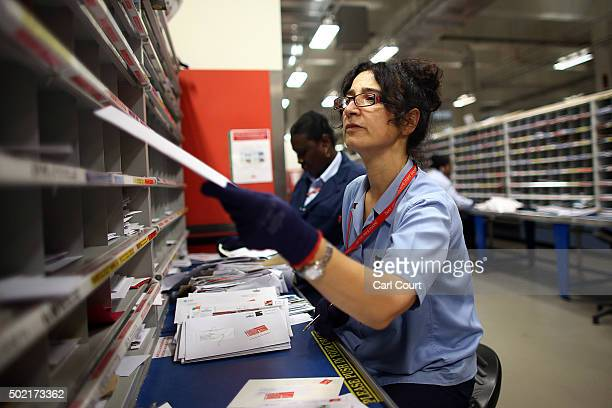 An employee manually sorts letters at Royal Mail's Mount Pleasant Mail Centre on December 21 2015 in London England This week is expected to be the...