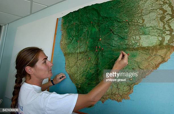 An employee maps out all the seismic control points linked to the Soufriere Volcano Observatory laboratory. The Soufriere volcano has been dormant...