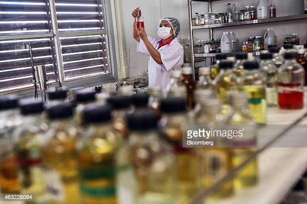 An employee mixes a shower gel solution at the research laboratory of the Vera Allied Manufacturing Co factory in Rangsit Thanyaburi Pathum Thani...