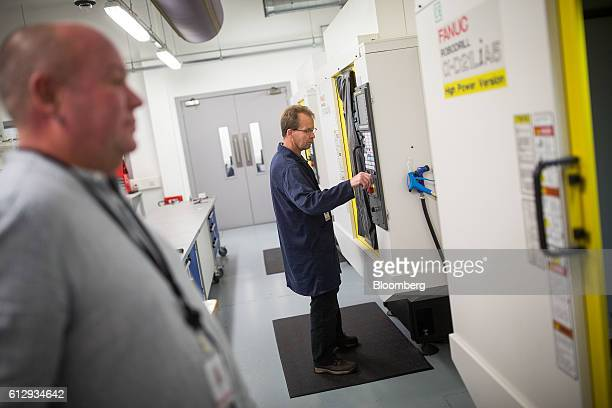 An employee monitors a cutting machine making an impeller for a Dyson digital motor inside the CNC lab at the Dyson Ltd campus in Malmesbury UK on...