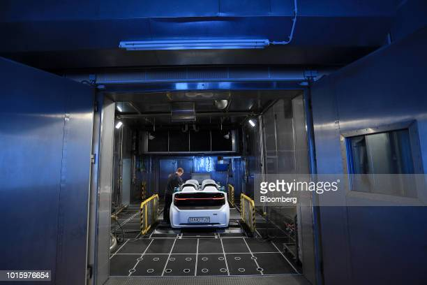 An employee monitors a Schaeffler Mover electric autonomous vehicle during chassis dynamometer testing in the Schaeffler AG factory in Herzogenaurach...