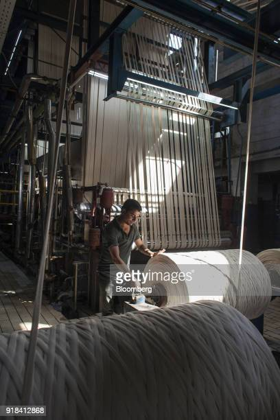 An employee monitors cotton rope in the dyeing plant at the Artistic Denim Mills Ltd factory in Karachi Pakistan on Tuesday Feb 6 2018 Pakistans...