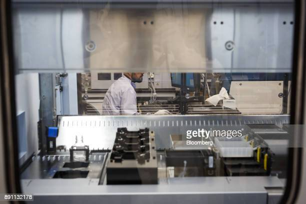 An employee monitors data from a mass spectrometre in the laboratory of the Centre for Commercialization of Regenerative Medicine at the MaRS...