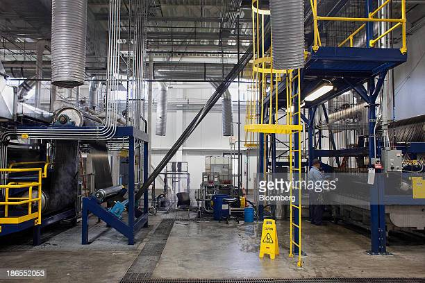 An employee monitors equipment at the SGL Automotive Carbon Fibers manufacturing plant in Moses Lake Washington US on October 9 2013 The US Census...