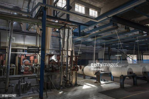 An employee monitors machinery in the dyeing plant at the Artistic Denim Mills Ltd factory in Karachi Pakistan on Tuesday Feb 6 2018 Pakistans...