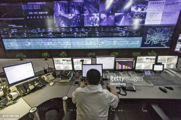 An employee monitors operations from a command and control center for the Shanghai Metro system in Shanghai China on Tuesday July 11 2017 The worlds...