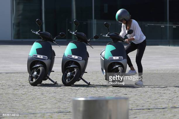 An employee mounts a Coup eScooter electric hire vehicle operated by Robert Bosch GmbH in Berlin Germany on Thursday Aug 17 2017 Coup is one of...