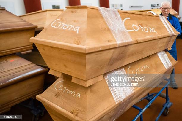 An employee move coffins with the lettering 'Corona' through the mourning hall before cremation at the crematorium in Meissen, eastern Germany on...