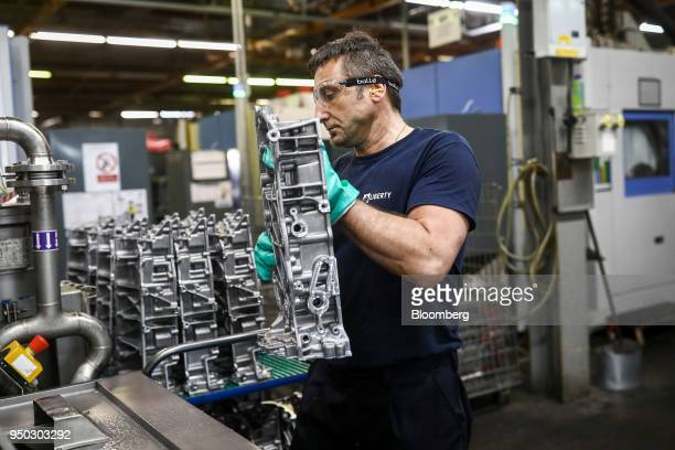 An employee moves a panther ladder frame from a cutting machine at Liberty Aluminium Technologies in Coventry UK on Monday April 23 2018 Aluminum...