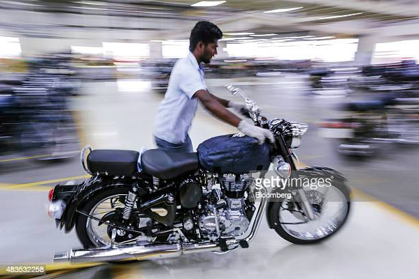 An employee moves a Royal Enfield Motors Ltd. Classic 350 motorcycle on the production line at the company's manufacturing facility in Chennai,...