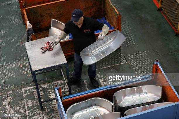 An employee moves aluminium metal at Liberty Pressing Solutions in Coventry UK on Monday April 23 2018 Aluminum markets are still reeling from US...