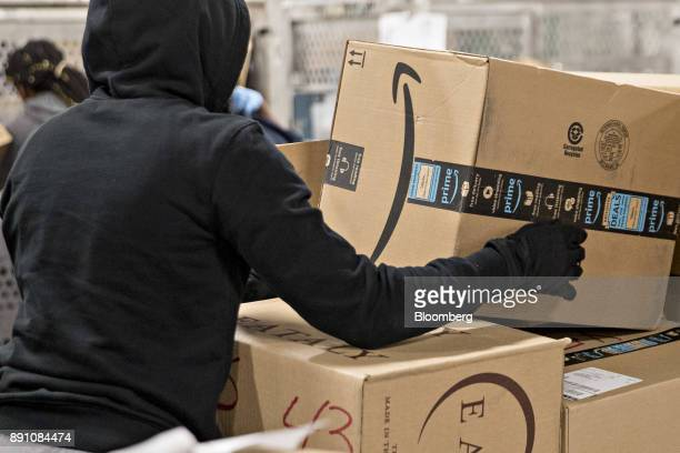 An employee moves an Amazoncom Inc package for delivery at the United States Postal Service Joseph Curseen Jr and Thomas Morris Jr processing and...