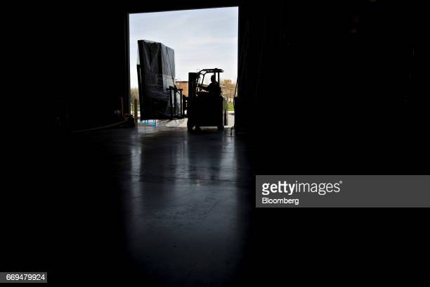 Blueprint robotics stock photos and pictures getty images an employee moves an order of walls on a forklift at the blueprint robotics facility in malvernweather Choice Image