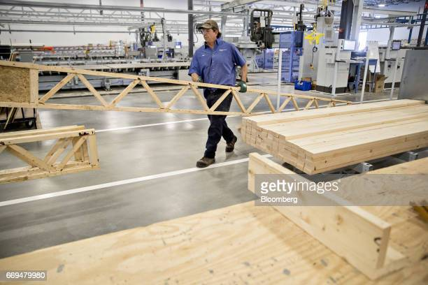 Blueprint robotics stock photos and pictures getty images an employee moves lumber in the floor assembly area of the blueprint robotics facility in baltimore malvernweather Choice Image