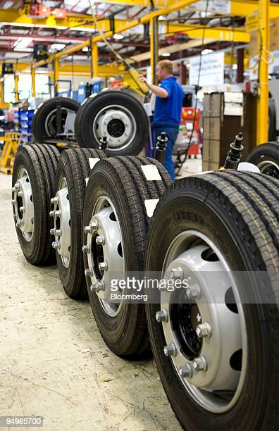 An employee moves wheels and axles at the Alexander Dennis bus factory in Guildford Surrey UK on Friday July 24 2009 Business Secretary Peter...