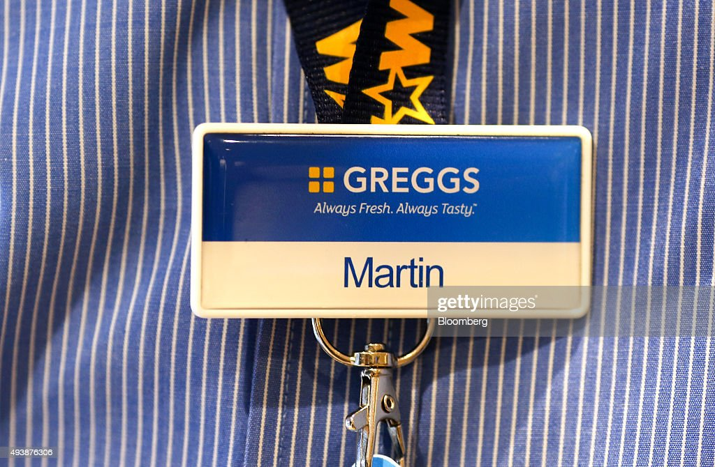 An employee name tag sits on a lanyard inside a Greggs Plc sandwich chain outlet in Caterham, U.K., on Thursday, Oct. 22, 2015. Same-store sales at Greggs have grown 5.6 percent so far in 2015, up from 3.9 percent across the same period last year, and the company said on Oct. 6 that full-year growth will exceed its previous forecast slightly. Photographer: Chris Ratcliffe/Bloomberg via Getty Images